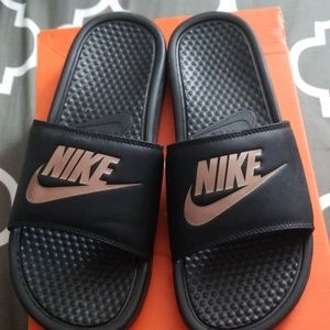 Rose gold and black Nike slides